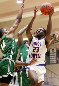 UMass Lowell vs Jacksonville men's basketball. Jacksonville's Mo Arnold (14) and UML's Christian Lutete (23).  (SUN/Julia Malakie)