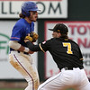UMass Lowell vs UMBC baseball. UML's Steve Passatempo (00) is caught off second base and tagged out by UMBC second baseman AJ Wright (7) in the bottom of the second inning of the second game. (SUN/Julia Malakie)
