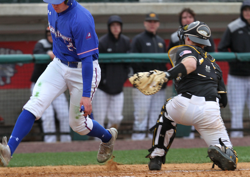 UMass Lowell vs UMBC baseball. UML's Russ Olive (24) is tagged out at the plate by UMBC catcher Zack Bright in the bottom of the second inning of second game. (SUN/Julia Malakie)