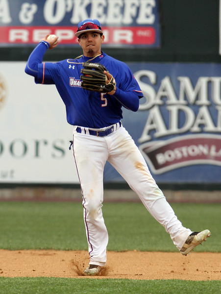 UMass Lowell vs UMBC baseball. Lowell shortstop Joey Castellanos (5) throws to first for an out in the top of the first inning.  (SUN/Julia Malakie)