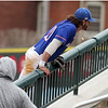 UMass Lowell vs UMBC baseball. UML first baseman Steve Passatempo leaps onto the railing going after a foul ball, but was not close enough. (SUN/Julia Malakie)