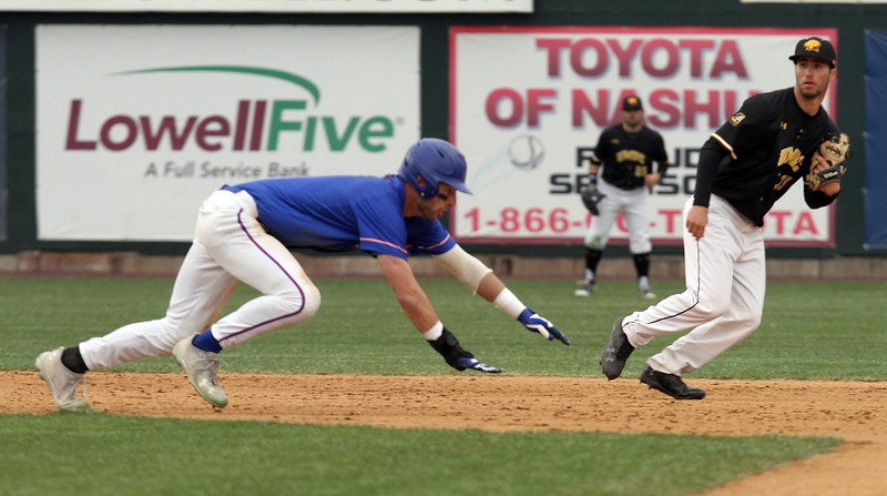 UMass Lowell vs UMBC baseball. UML's Colby Maiola (6) dives back to second base past UMBC shortstop Andres Machado (35) in the bottom of the first inning. (SUN/Julia Malakie)