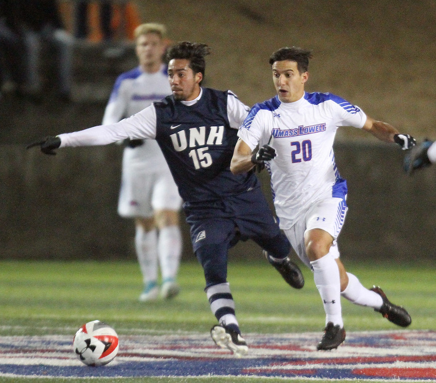 . UMass Lowell vs UNH men\'s soccer in America East tournament game. UNH\'s Alex Valencia (15) and UML\'s Federico Ferre (20). (SUN/Julia Malakie)