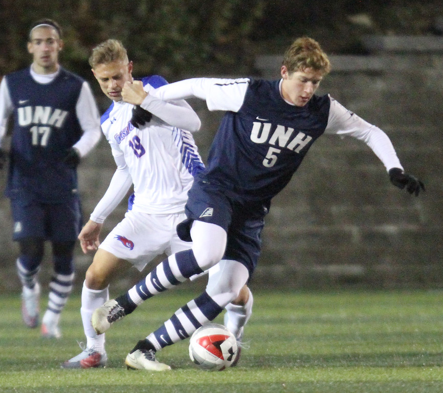 . UMass Lowell vs UNH men\'s soccer in America East tournament game. UML\'s Roko Prsa (19) and Josh Bauer (5). (SUN/Julia Malakie)