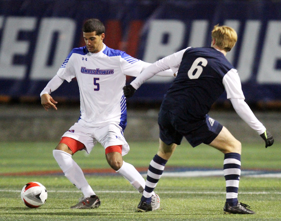 ". UMass Lowell vs UNH men\'s soccer in America East tournament game. UML""s Franky Martinez (5) and UNH\'s Siggi Geirsson (6). (SUN/Julia Malakie)"