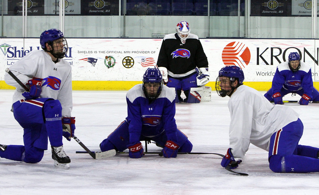 . UMass Lowell hockey practice. Players including Connor Wilson (17), center, stretch after practice.  (SUN Julia Malakie)