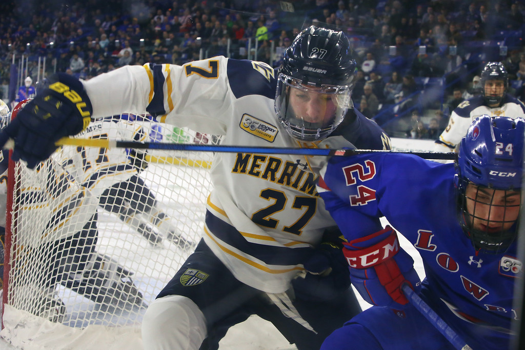 . UMass Lowell vs Merrimack College hockey. Merrimack\'s Dominic Dockery (27) and UML\'s Lucas Condotta (24). (SUN Julia Malakie)