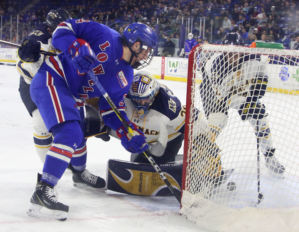 . UMass Lowell vs Merrimack College hockey. UML\'s Lucas Condotta (24) attempts to score past Merrimack goalie Craig Pantano (29) and Ryan Cook (2). (SUN Julia Malakie)