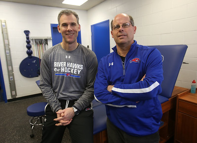 UMass Lowell hockey head coach Norm Bazin, with head athletic trainer Artie Poitras, longtime trainer for the hockey team, at Tsongas Center at UMass Lowell.  (SUN/Julia Malakie)