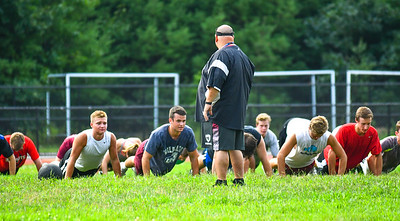 U.S. Marines work out Groton-Dunstable football players and cheerleaders