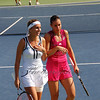 In a light moment, the number one ladies doubles team, Gisela Dulko (ARG - white) and Flavia Pennetta (ITA - rose), discussing strategy before play.