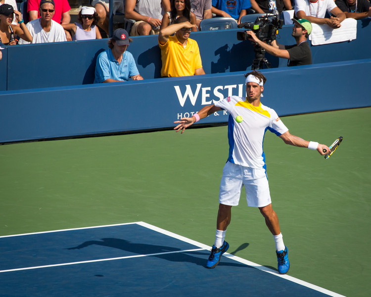 Feliciano Lopez keeps his eyes on the ball as he hits a forehand at the 2012 US Open