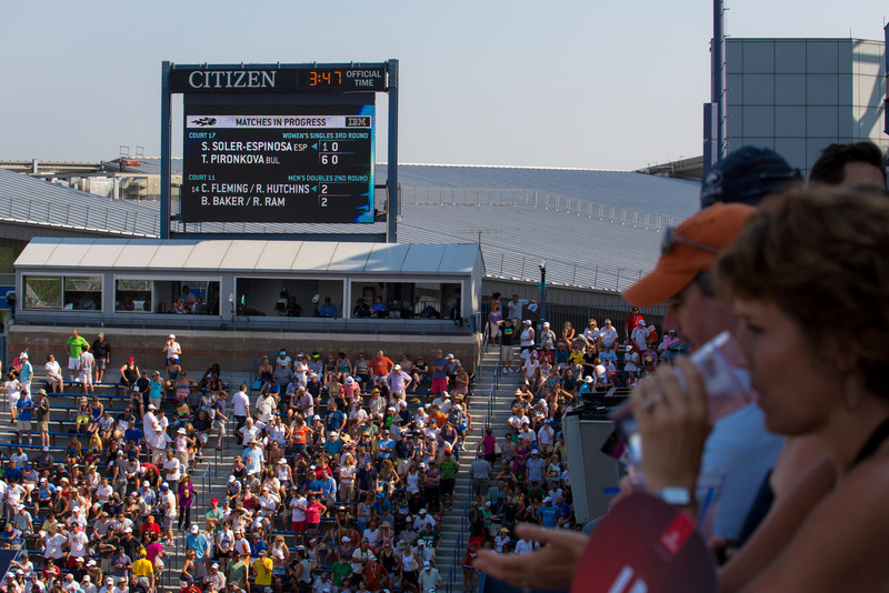 Fans watch a US Open tennis match on Grandstand stadium