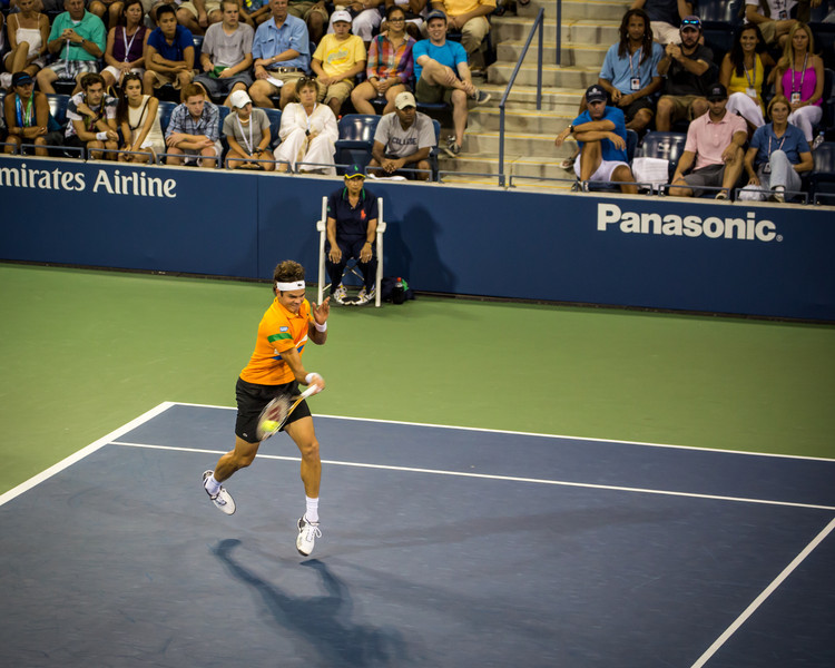Milos Raonic stepps in to hit a blistering forehand at the US Open 2012
