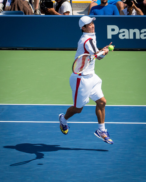 Kai Nishikori hits a forehand at the 2012 US Open