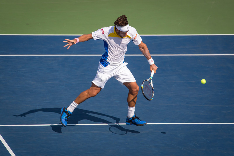 Feliciano Lopez hits a backhand at the 2012 US Open