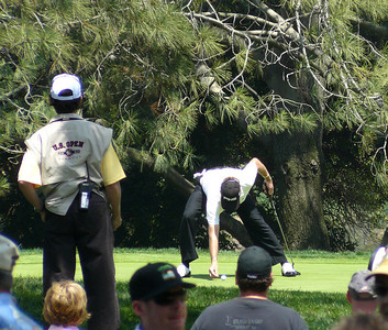 Jimenez placing ball US Open golf 080612 P1440181