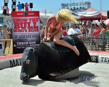 Bikini girl bull riding at the US Open of Surfing
