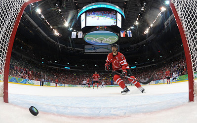 Canada's Scott Niedermayer (27) watches USA's Ryan Kesler's goal score in third period in men's preliminary round hockey play at the Vancouver 2010 Olympics in Vancouver, British Columbia, Sunday, Feb. 21, 2010. The USA won 5-3.  (AP Photo/Bruce Bennett, Pool)