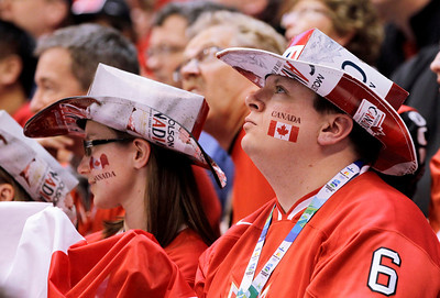 Canada fans watch in the third period of a preliminary round men's ice hockey game against USA at the Vancouver 2010 Olympics in Vancouver, British Columbia, Sunday, Feb. 21, 2010. (AP Photo/Julie Jacobson)