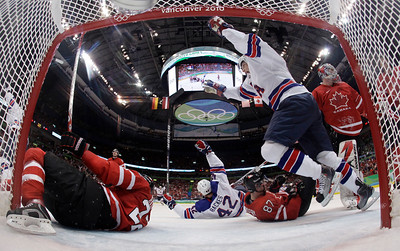 USA's Bobby Ryan celebrates a goal against Canada by teammate Chris Drury, not shown, in the second period of a preliminary round men's ice hockey game at the Vancouver 2010 Olympics in Vancouver, British Columbia, Sunday, Feb. 21, 2010. Canada's Dan Boyle (22), left, Sidney Crosby (87), center, and  goalie Martin Brodeur (30) were in on the play. (AP Photo/Julie Jacobson)