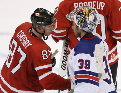 Canada's Sidney Crosby, left, shakes hands with USA goaltender Ryan Miller following the U.S.A.'s 5-3 win at men's Olympic hockey action at the 2010 Winter Olympic Games in Vancouver, British Columbia, Sunday Feb. 21, 2010.  (AP Photo/The Canadian Press, Jonathan Hayward)