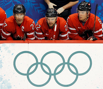 Canada teammates Scott Niedermayer, left to right, Dan Boyle and Shea Weber watch the closing minutes of their game against the USA during third period men's ice hockey action Sunday, Feb. 21, 2010 at the 2010 Winter Olympic Games in Vancouver, British Columbia. USA won 5-3. (AP Photo/The Canadian Press, Ryan Remiorz)