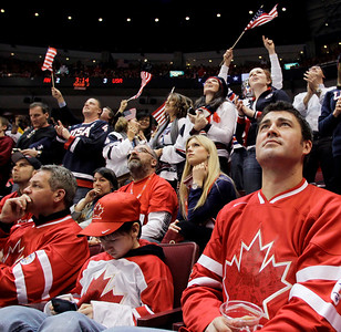 Fans watch the third period of a preliminary round men's ice hockey game between USA and Canada at the Vancouver 2010 Olympics in Vancouver, British Columbia, Sunday, Feb. 21, 2010. (AP Photo/Julie Jacobson)