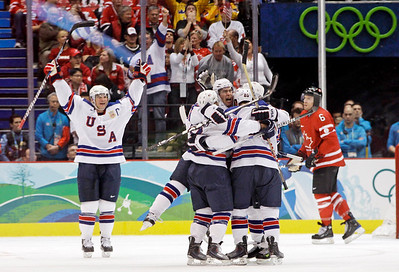 Canada's Shea Weber (6) watches as USA players celebrate a goal in the third period of a preliminary round men's ice hockey game at the Vancouver 2010 Olympics in Vancouver, British Columbia, Sunday, Feb. 21, 2010. (AP Photo/Julie Jacobson)