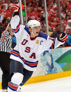 USA's Jamie Langenbrunner celebrates his third period goal against Canada during men's Olympic ice hockey action between Canada and the U.S.A. at Canada Hockey Place in Vancouver, British Columbia,  Sunday, Feb.  21, 2010 at the 2010 Vancouver Olympic Winter Games in Vancouver. (AP Photo/The Canadian Press, Scott Gardner)