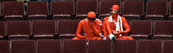 Fans react after a preliminary round men's ice hockey game between USA and Canada at the Vancouver 2010 Olympics in Vancouver, British Columbia, Sunday, Feb. 21, 2010. (AP Photo/Matt Slocum)