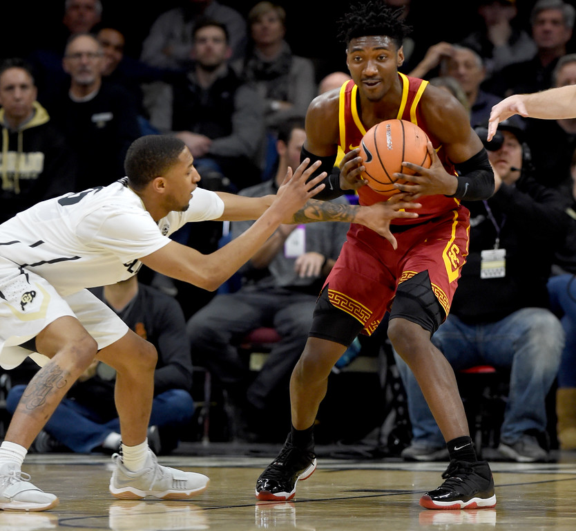 . Dominique Collier, left, of CU, tries to steal the ball from Jonah Mathews, of USC.  Cliff Grassmick / Staff Photographer/ February 21, 2018