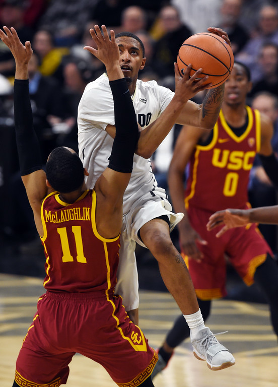 . Dominique Collier, of CU, drives on Jordan McLaughlin, of USC, in the second half.  Cliff Grassmick / Staff Photographer/ February 21, 2018