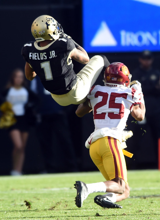. Shay Fields, of CU is upended by Jack Jones, of USC, during the November 11th, 2017 game in Boulder.  Cliff Grassmick / Staff Photographer/ November 11, 2017, 2017