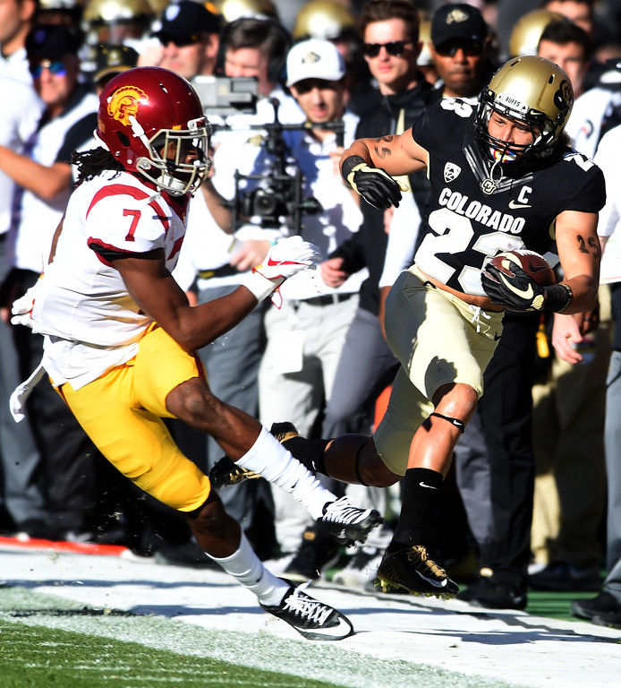 . Marvin Tell II, of USC, knocks Phillip Lindsay, of CU, out of bounds during the November 11th, 2017 game in Boulder.  Cliff Grassmick / Staff Photographer/ November 11, 2017, 2017
