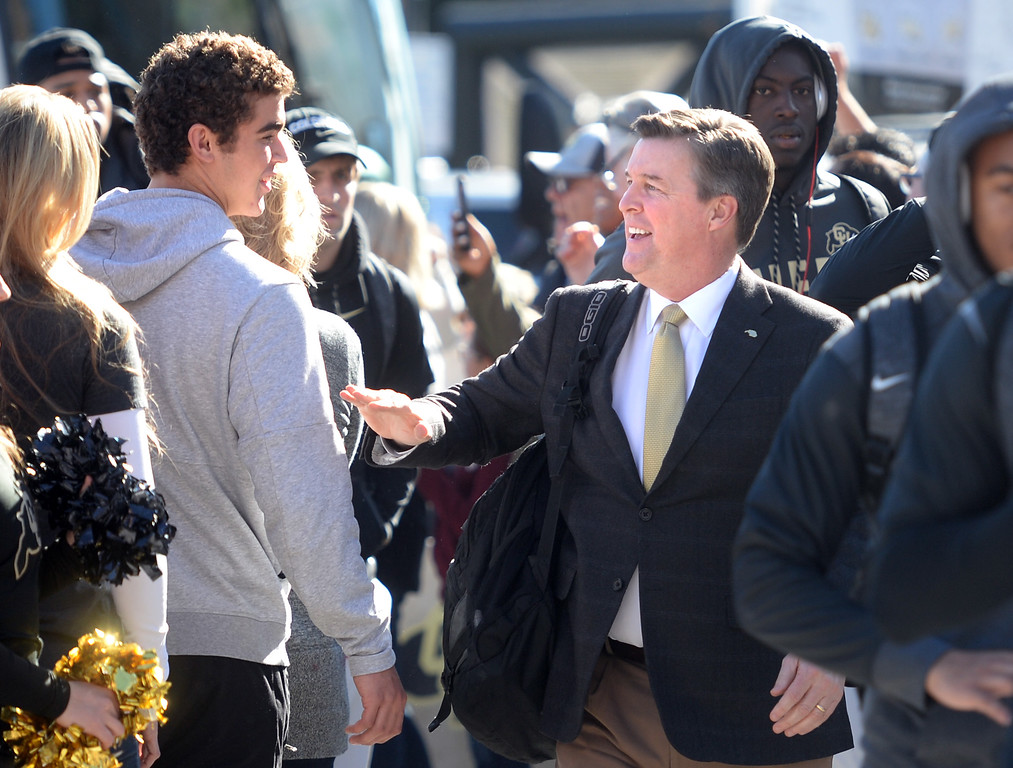 . CU head coach, Mike MacIntyre, greets the crowd before the November 11th, 2017 game in Boulder.  Cliff Grassmick / Staff Photographer/ November 11, 2017, 2017