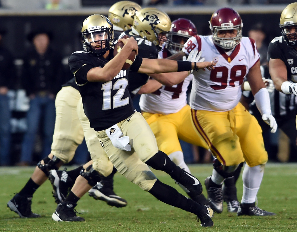 . Steven Montez, of CU, spins away from the USC pass rush during the November 11th, 2017 game in Boulder.  Cliff Grassmick / Staff Photographer/ November 11, 2017, 2017