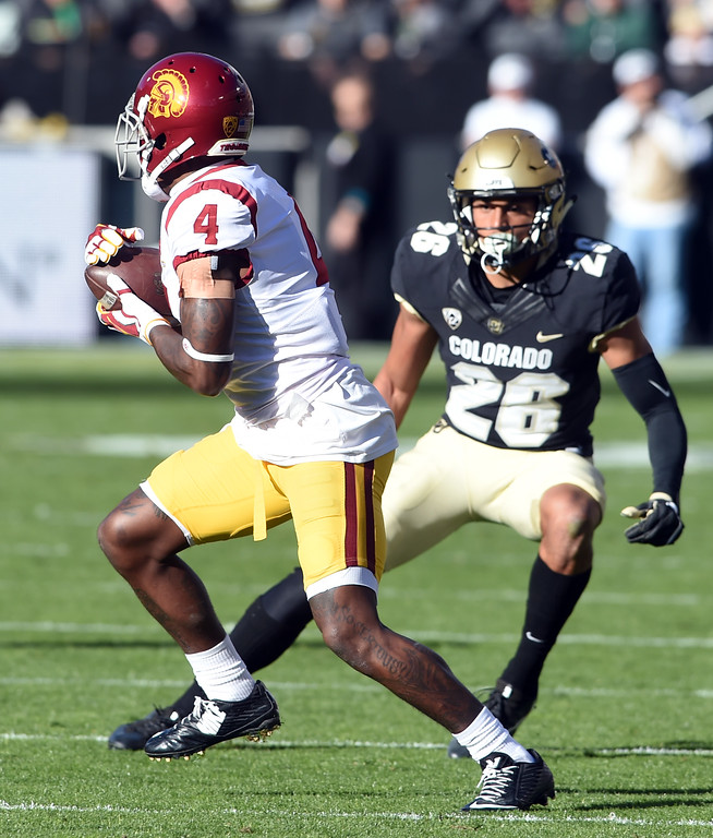 . Steven Mitchell, Jr. of USC, tries to get away from Isaiah Oliver, of CU, during the November 11th, 2017 game in Boulder.  Cliff Grassmick / Staff Photographer/ November 11, 2017, 2017