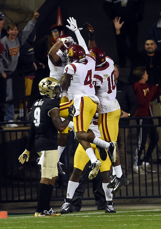 . USC celebrates their INT score during the November 11th, 2017 game in Boulder.  Cliff Grassmick / Staff Photographer/ November 11, 2017, 2017