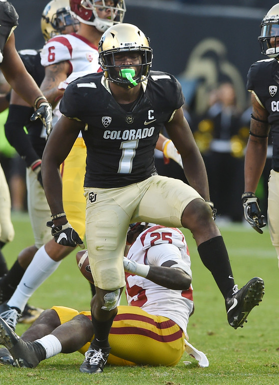 . Afolabi Laguda, of CU, celebrates a tackle for a loss during the November 11th, 2017 game in Boulder.  Cliff Grassmick / Staff Photographer/ November 11, 2017, 2017