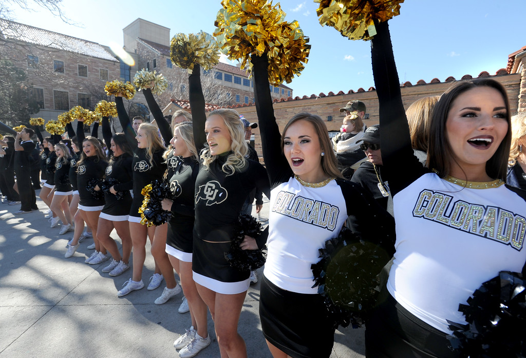 . The CU spirit squad greet the players coming off the bus before the November 11th, 2017 game in Boulder.  Cliff Grassmick / Staff Photographer/ November 11, 2017, 2017