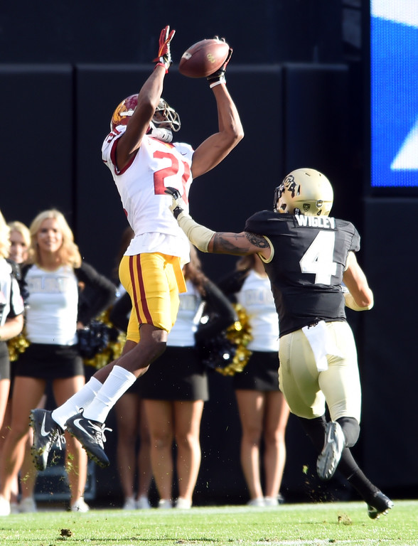 . Tyler Vaughns, of USC, catches a pass over Dante Wigley, of CU, during the November 11th, 2017 game in Boulder.  Cliff Grassmick / Staff Photographer/ November 11, 2017, 2017