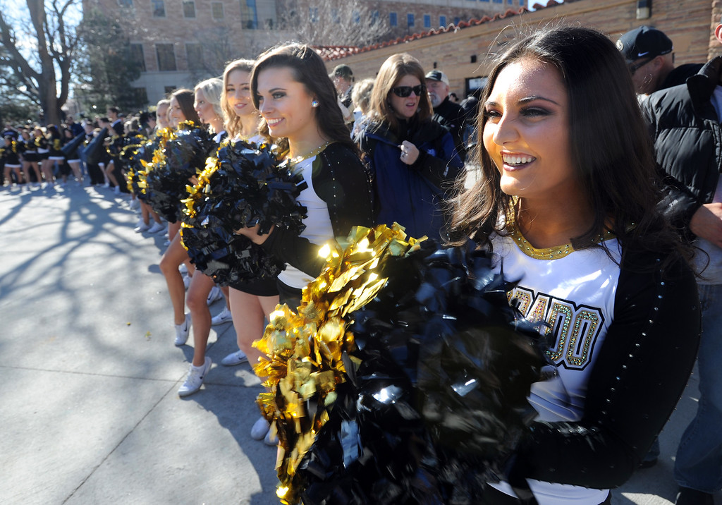 . Brittany R. and the spirit squad greet the players coming off the bus before the November 11th, 2017 game in Boulder.  Cliff Grassmick / Staff Photographer/ November 11, 2017, 2017