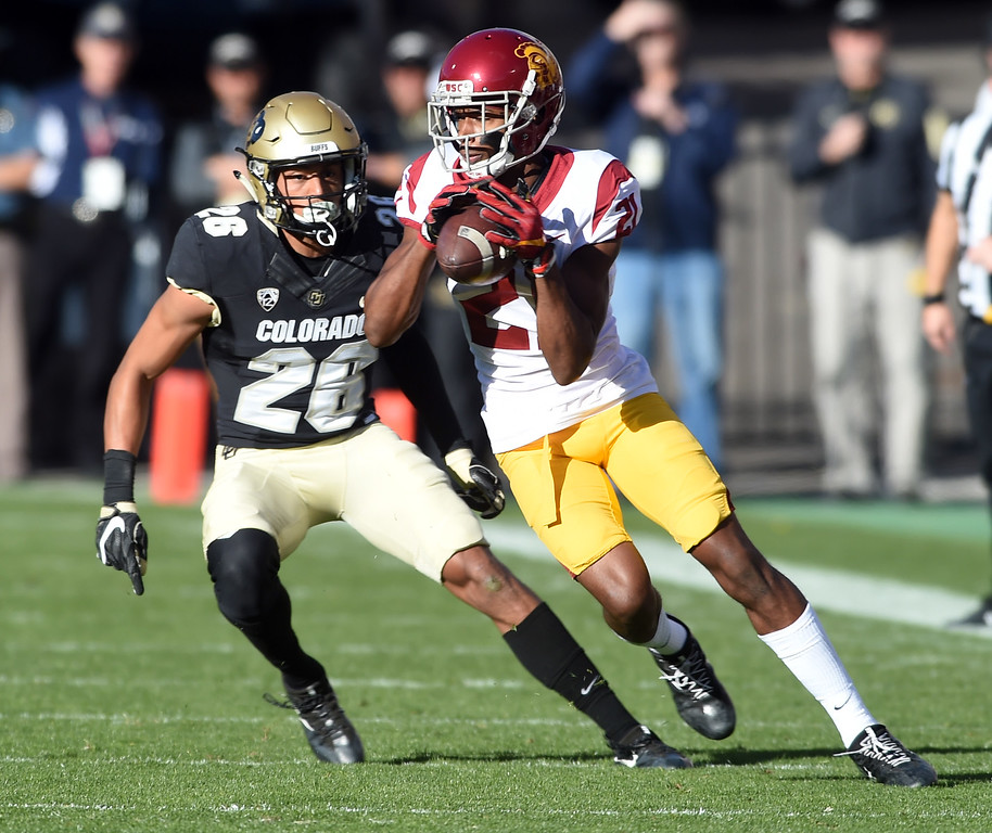 . Tyler Vaughns, of USC, makes a catch in front of Isaiah Oliver, of CU, during the November 11th, 2017 game in Boulder.  Cliff Grassmick / Staff Photographer/ November 11, 2017, 2017