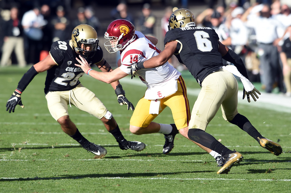 . USC QB, Sam Darnold, tries to escape Drew Lewis, left, and Evan Worthington, of CU, during the November 11th, 2017 game in Boulder.  Cliff Grassmick / Staff Photographer/ November 11, 2017, 2017