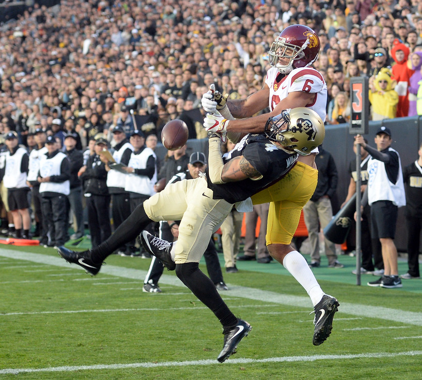 . Dante Wigley, of CU, breaks up a TD pass meant for Michael Pittman II, of USC, during the November 11th, 2017 game in Boulder.  Cliff Grassmick / Staff Photographer/ November 11, 2017, 2017