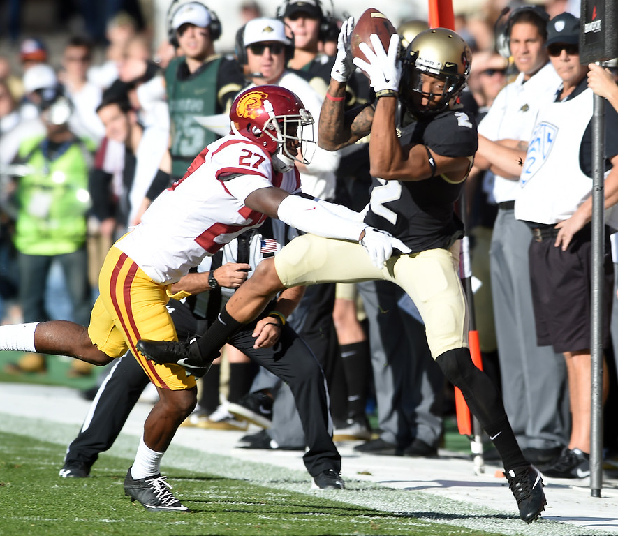 . Ajene Harris, of USC, pushes out Devin Ross, of CU, during the November 11th, 2017 game in Boulder.  Cliff Grassmick / Staff Photographer/ November 11, 2017, 2017