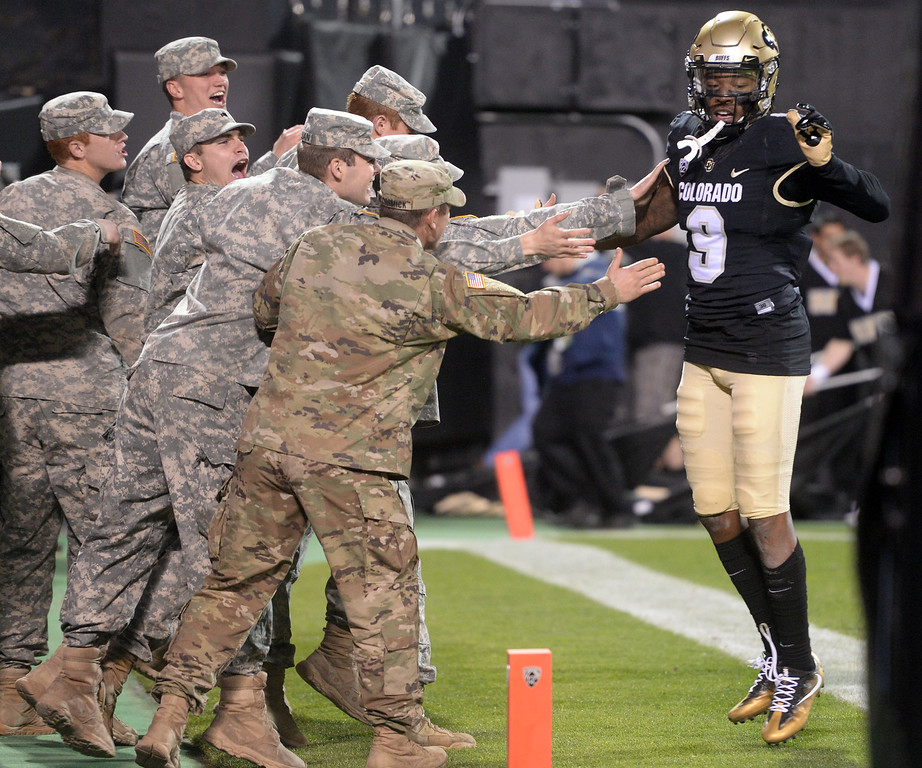 . Juwann Winfree, of CU, celebrates with the troops during the November 11th, 2017 game in Boulder.  Cliff Grassmick / Staff Photographer/ November 11, 2017, 2017