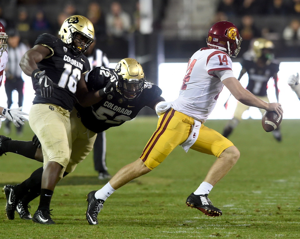. Sam Darnold, USC QB, tries to escape Leo Jackson III and Chris Mulumba, of CU,  during the November 11th, 2017 game in Boulder.  Cliff Grassmick / Staff Photographer/ November 11, 2017, 2017