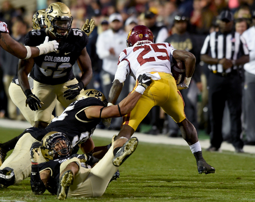 . Ronald Jones II, of USC, was hard for the Buffs to bring down during the November 11th, 2017 game in Boulder.  Cliff Grassmick / Staff Photographer/ November 11, 2017, 2017